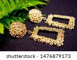golden close up earring on...   Shutterstock . vector #1476879173