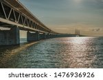 The Øresund Bridge is a 8-km-long bridge + 4 km-long tunnel below the sea, which connects Denmark to Sweden across the Øresund strait.