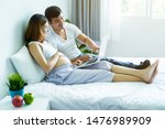 pregnant women and husband are... | Shutterstock . vector #1476989909