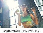 happiness and sporty woman... | Shutterstock . vector #1476990119