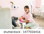 smiling female pedicurist... | Shutterstock . vector #1477026416
