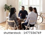 Small photo of Male psychologist counselor therapist coach speak at group therapy session psychotherapy meeting supporting helping patients in substance addiction mental problem talk sit in circle in rehab concept