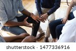 Small photo of African man counselor therapist coach psychologist speak at group counseling therapy session concept encourage support patients in addiction talk share problem sit in circle in rehab, close up view