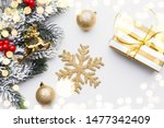 gold snow flake gift box holly... | Shutterstock . vector #1477342409