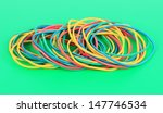colorful rubber bands on green... | Shutterstock . vector #147746534