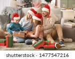 Happy Family With Gift Boxes In ...