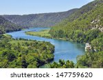 Scenic View Of Winding Blue...
