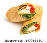 Wrap sandwich with feta cheese and red peppers. - stock photo