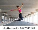 fitness woman jumping outdoor... | Shutterstock . vector #1477686170