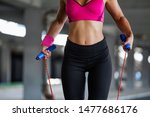 sporty woman warming up with... | Shutterstock . vector #1477686176