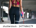 sporty woman warming up with... | Shutterstock . vector #1477686179