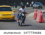 Small photo of Motorcycle taxi in Cartagena, Colombia. Motorbike driver driving with a customer as pillion between busy traffic