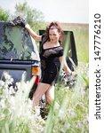 girl in a car stuck in a swamp   Shutterstock . vector #147776210