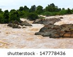 Muddy Waterfall With Rain At...