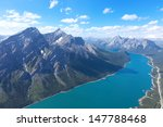 view from helicopter at beautiful mountains and river in jasper national park, alberta, canada