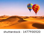 Small photo of Travel concept. Amazing view of sand dunes with hot air balloons in the Sahara Desert. Location: Sahara Desert, Morocco. Artistic picture. Beauty world.