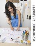 female fashion designer working ... | Shutterstock . vector #147806954