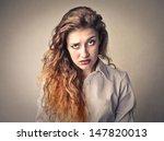 Portrait Of Puzzled Woman