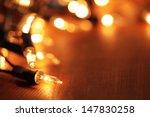 Christmas Lights On Dark Woode...