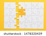 Small photo of Yellow piece connect with white puzzle pieces on plain background