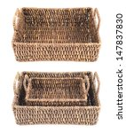 Brown wicker basket, box shaped, isolated over white background, set of two foreshortenings - stock photo
