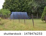 Outwell sign on tent - camping site and spot in green garden in sunny and summer season - Norway (7th august 2019) - stock photo