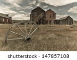 Wagon Wheel With Old Building...