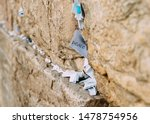 Small photo of Notes on the wailing (Western) wall in Jerusalem Israel. Peace written in one of the notes