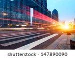 the light trails on the modern... | Shutterstock . vector #147890090