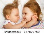 siblings cuddling in bed | Shutterstock . vector #147899750