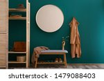 Round Mirror On Green Wall In...