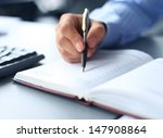 businessman makes a note in... | Shutterstock . vector #147908864