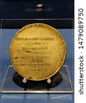 Small photo of Manchester Greater Manchester UK August 14 2019 Approximately 200 year old Peterloo commemorative medal displayed at the People's History Museum as part of Peterloo 200 with text god confound them