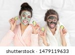 Young Friends With Facial Masks ...