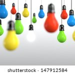 Hanging multicolored light bulb on bright background. - stock photo