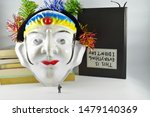 Small photo of The mask is an object that is worn on the face. Usually the mask used to accompany the music of local arts. Masks in the regional arts are generally to respect the worship or to clarify the character