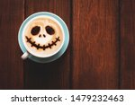 Stock photo cup of coffee with scary jack s face halloween background halloween party 1479232463