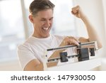 excited mature man clenching... | Shutterstock . vector #147930050