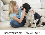 little girl playing with pet... | Shutterstock . vector #147931514