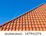 Red Roof Tiles On Blue Sky