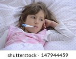 sick girl resting in bed with... | Shutterstock . vector #147944459