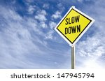 Slow Down Yellow Road Sign On...