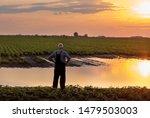 Senior Farmer In Overalls...