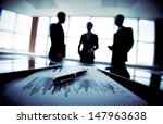 shady image of a business team... | Shutterstock . vector #147963638