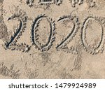 Small photo of Number twenty twenty on beach sand
