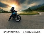 Motorcycle Driver Posing In...