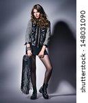 rock girl  in black clothes   Shutterstock . vector #148031090