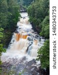 Small photo of Corra Linn waterfall in full spate on the River Clyde near New Lanark, Scotland, UK.