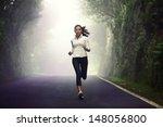 woman running on road. female... | Shutterstock . vector #148056800