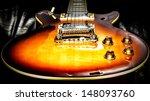 Les Paul Shape Guitar On Back...